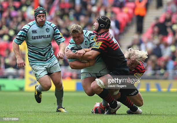 Tom Youngs of Leicester is tackled by Steve Borthwick during the Aviva Premiership match between Saracens and Leicester Tigers at Wembley Stadium on...