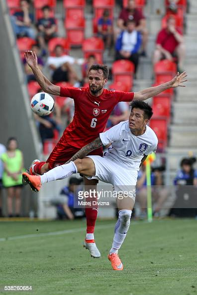 Toma Sivok of Czech Republic competes for the ball with Suk Hyunjun of Korea during an international friendly match between Czech Republic and Korea...