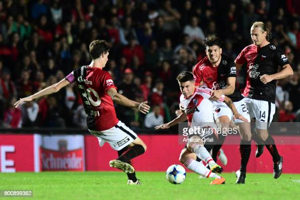 Tomas Andrade of River Plate fights for the ball with German Conti of Colon during a match between Colon and River Plate as part of Torneo Primera...