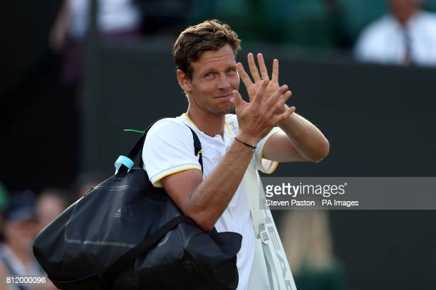 Tomas Berdych acknowledges the crowd after beating Dominic Thiem on day seven of the Wimbledon Championships at The All England Lawn Tennis and...
