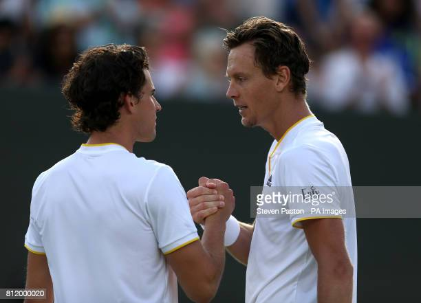 Tomas Berdych and Dominic Thiem shake hands after their match on day seven of the Wimbledon Championships at The All England Lawn Tennis and Croquet...