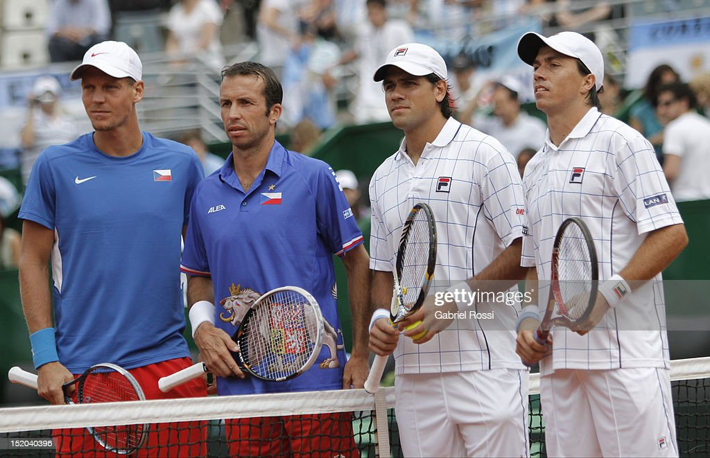 <a gi-track='captionPersonalityLinkClicked' href=/galleries/search?phrase=Tomas+Berdych&family=editorial&specificpeople=239147 ng-click='$event.stopPropagation()'>Tomas Berdych</a> and <a gi-track='captionPersonalityLinkClicked' href=/galleries/search?phrase=Radek+Stepanek&family=editorial&specificpeople=193842 ng-click='$event.stopPropagation()'>Radek Stepanek</a> of Czech Republic and <a gi-track='captionPersonalityLinkClicked' href=/galleries/search?phrase=Carlos+Berlocq&family=editorial&specificpeople=553854 ng-click='$event.stopPropagation()'>Carlos Berlocq</a> and Eduardo Shuank of Argentina poses for the photo during the match between Argentina and Czech Republic as part of the second day of the Davis Cup Semi-final at Mary Tern de Weiss Stadium on September 15, 2012 in Buenos Aires, Argentina.