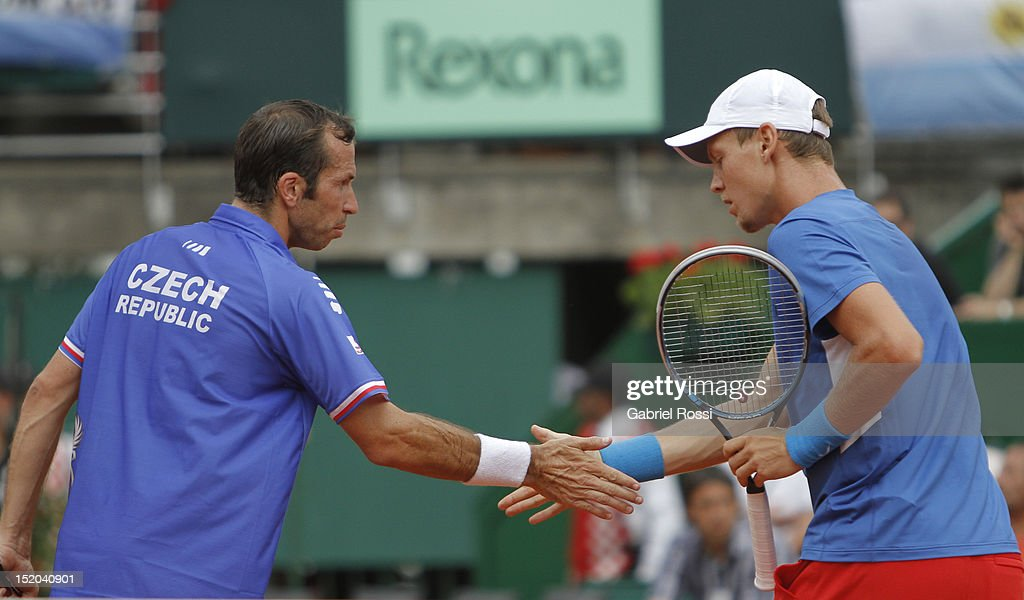 <a gi-track='captionPersonalityLinkClicked' href=/galleries/search?phrase=Tomas+Berdych&family=editorial&specificpeople=239147 ng-click='$event.stopPropagation()'>Tomas Berdych</a> and <a gi-track='captionPersonalityLinkClicked' href=/galleries/search?phrase=Radek+Stepanek&family=editorial&specificpeople=193842 ng-click='$event.stopPropagation()'>Radek Stepanek</a> of Czech Republic celebrate a point during the match between Argentina and Czech Republic as part of the second day of the Davis Cup Semi-final at Mary Tern de Weiss Stadium on September 15, 2012 in Buenos Aires, Argentina.