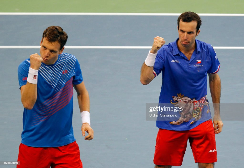 Tomas Berdych (L) and Radek Stepanek of Czech Republic celebrate victory in their men's doubles match on day two of the Davis Cup World Group Final between Serbia and Czech Republic at Kombank Arena on November 16, 2013 in Belgrade, Serbia.