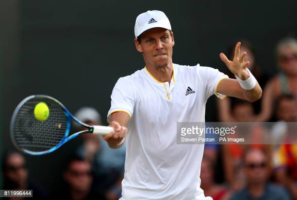 Tomas Berdych in action against Dominic Thiem on day seven of the Wimbledon Championships at The All England Lawn Tennis and Croquet Club Wimbledon