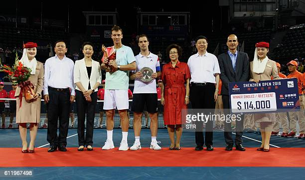 Tomas Berdych of Czech Republic and Richard Gasquet of France pose with their trophies after their men's singles final match at Shenzhen Open ATP...