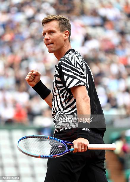 Tomas Berdych of Czech Republic celebrates his victory during the Men's Singles second round match against Malek Jaziri of Tunisia on day five of the...