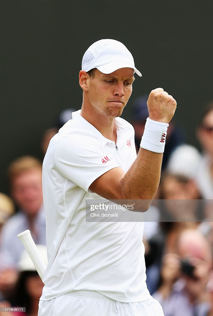 Tomas Berdych of Czech Republic celebrates match point during his Gentlemen's Singles second round match against Daniel Brands of Germany on day four of the Wimbledon Lawn Tennis Championships at the All England Lawn Tennis and Croquet Club on June 27, 2013 in London, England.