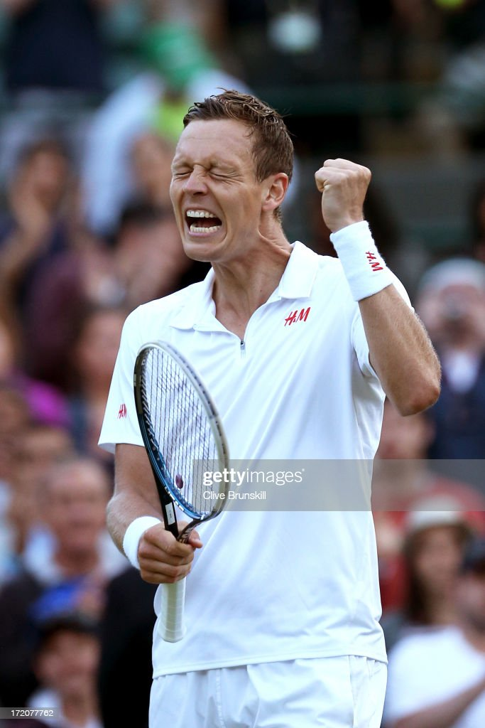 Tomas Berdych of Czech Republic celebrates match point during the Gentlemen's Singles fourth round match against Bernard Tomic of Australia on day seven of the Wimbledon Lawn Tennis Championships at the All England Lawn Tennis and Croquet Club on July 1, 2013 in London, England.