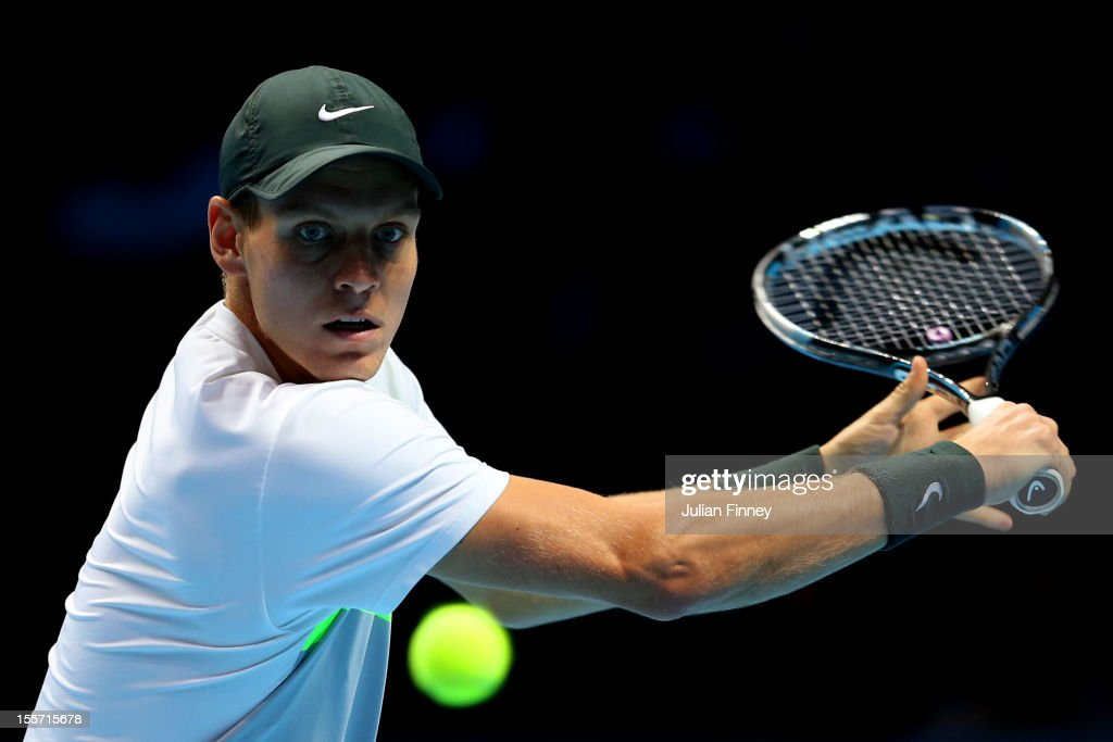 <a gi-track='captionPersonalityLinkClicked' href=/galleries/search?phrase=Tomas+Berdych&family=editorial&specificpeople=239147 ng-click='$event.stopPropagation()'>Tomas Berdych</a> of Czech Republic hits a backhand during the men's singles match against Jo-Wilfried Tsonga of France on day three of the ATP World Tour Finals at the at O2 Arena on November 7, 2012 in London, England.