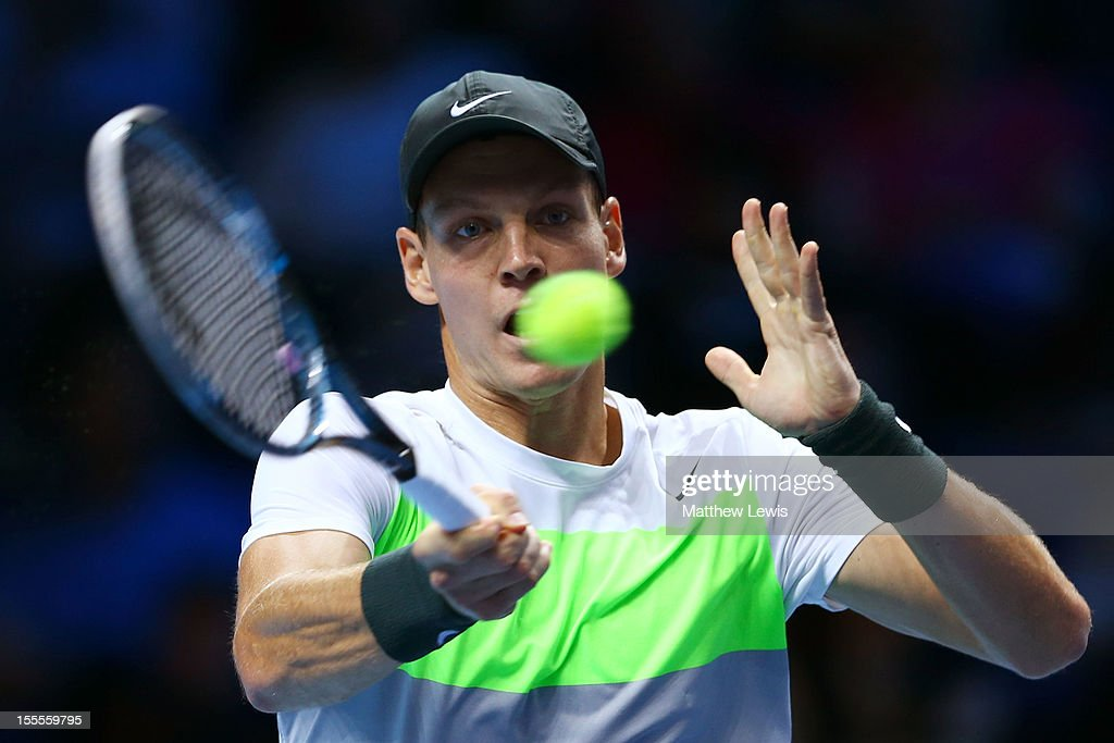 Tomas Berdych of Czech Republic hits a forehand during the men's singles match against <a gi-track='captionPersonalityLinkClicked' href=/galleries/search?phrase=Andy+Murray+-+Jogador+de+t%C3%A9nis&family=editorial&specificpeople=200668 ng-click='$event.stopPropagation()'>Andy Murray</a> of Great Britain on day one of the ATP World Tour Finals at the O2 Arena on November 5, 2012 in London, England.