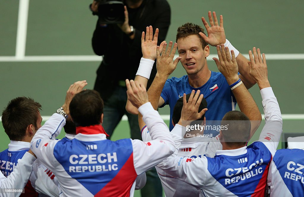 <a gi-track='captionPersonalityLinkClicked' href=/galleries/search?phrase=Tomas+Berdych&family=editorial&specificpeople=239147 ng-click='$event.stopPropagation()'>Tomas Berdych</a> of Czech Republic is congratulated by his team mates after his five set win against Nicolas Almagro of Spain during day one of the final Davis Cup match between Czech Republic and Spain at the 02 Arena on November 16, 2012 in Prague, Czech Republic.