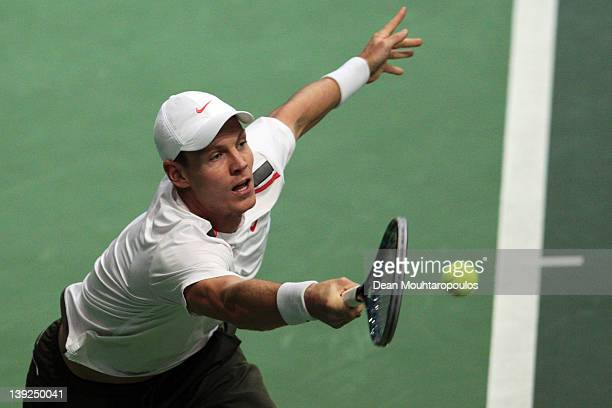 Tomas Berdych of Czech Republic lunges for the ball against Juan Martin Del Porto of Argentina in the semi final on day 6 of the ABN AMRO World...