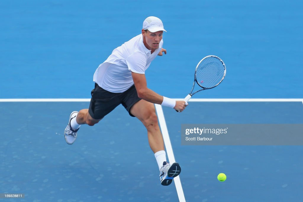 <a gi-track='captionPersonalityLinkClicked' href=/galleries/search?phrase=Tomas+Berdych&family=editorial&specificpeople=239147 ng-click='$event.stopPropagation()'>Tomas Berdych</a> of Czech Republic plays a backhand during his match against Marcos Baghdatis of Cyprus during day four of the AAMI Classic at Kooyong on January 12, 2013 in Melbourne, Australia.
