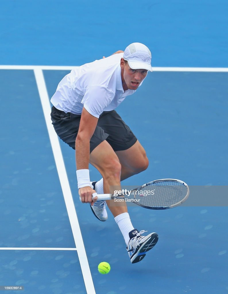 Tomas Berdych of Czech Republic plays a backhand during his match against Marcos Baghdatis of Cyprus during day four of the AAMI Classic at Kooyong on January 12, 2013 in Melbourne, Australia.