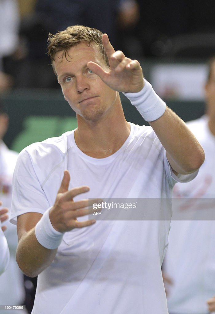 Tomas Berdych of Czech Republic reacts after beating Henri Laaksonen of Switzerland of the Davis Cup World Group first round match on February 1, 2013 in Geneva.