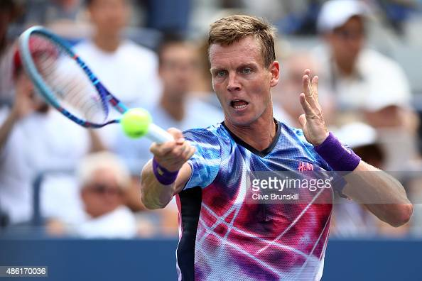 Tomas Berdych of Czech Republic returns a shot against Bjorn Fratangelo of the United States during their Men's Singles First Round match on Day Two...