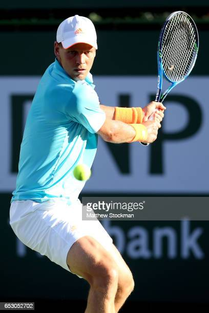 Tomas Berdych of Czech Republic returns a shot to Yoshihito Nishioka of Japan during the BNP Paribas Open at the Indian Wells Tennis Garden on March...