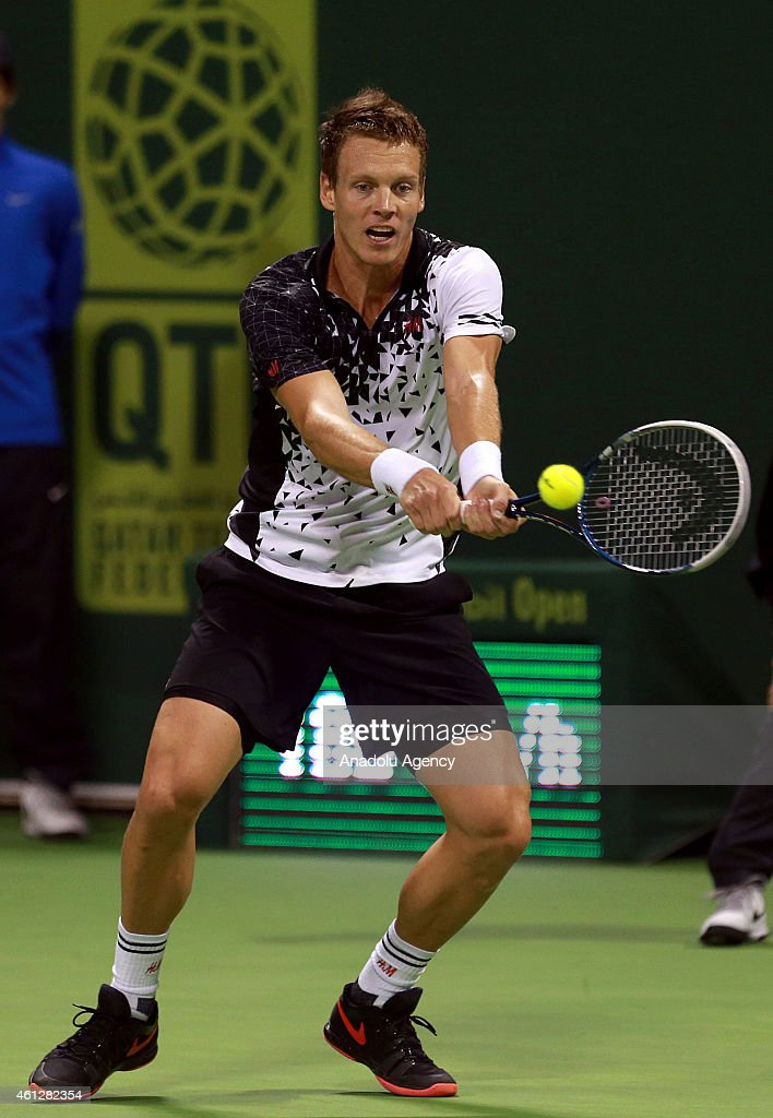 Tomas Berdych of Czech Republic returns the ball to David Ferrer of Spain during the final match of the Qatar ExxonMobil ATP Open Tennis tournament at the Khalifa Tennis Complex in Doha, Qatar on 10 January 2015.
