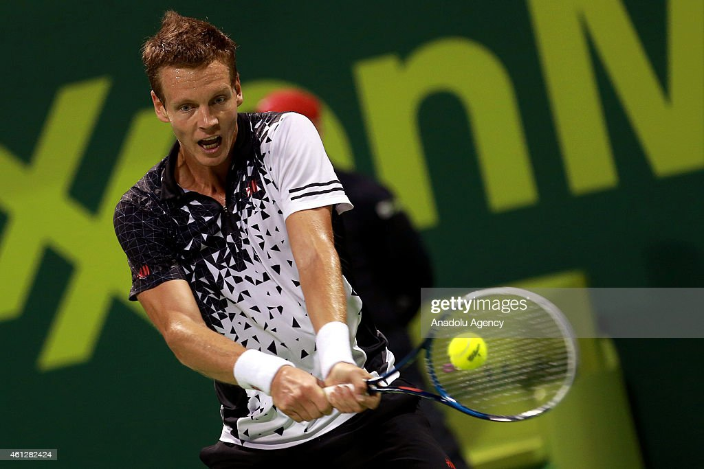 Tomas Berdych of Czech Republic returns the ball to David Ferrer of Spain during the final match of the Qatar ExxonMobil ATP Open Tennis tournament at the Khalifa Tennis Complex in Doha, Qatar on January 10, 2015.