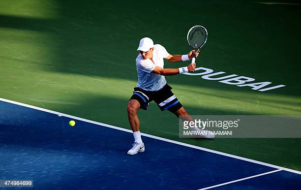 Tomas Berdych of Czech Republic returns the ball to Sergiy Stakhovsky of Ukraine during their match on the third day of the ATP Dubai Duty Free...