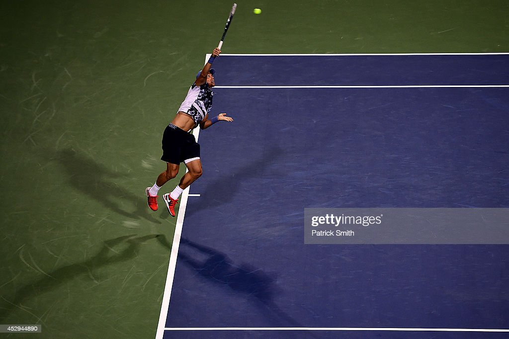 <a gi-track='captionPersonalityLinkClicked' href=/galleries/search?phrase=Tomas+Berdych&family=editorial&specificpeople=239147 ng-click='$event.stopPropagation()'>Tomas Berdych</a> of Czech Republic serves a shot to Robby Ginepri of the United States during Day 3 of the Citi Open at the William H.G. FitzGerald Tennis Center on July 30, 2014 in Washington, DC.