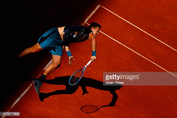 Tomas Berdych of Czech Republic serves to John Isner of USA in the quarter finals during day seven of the Mutua Madrid Open tennis tournament at the...