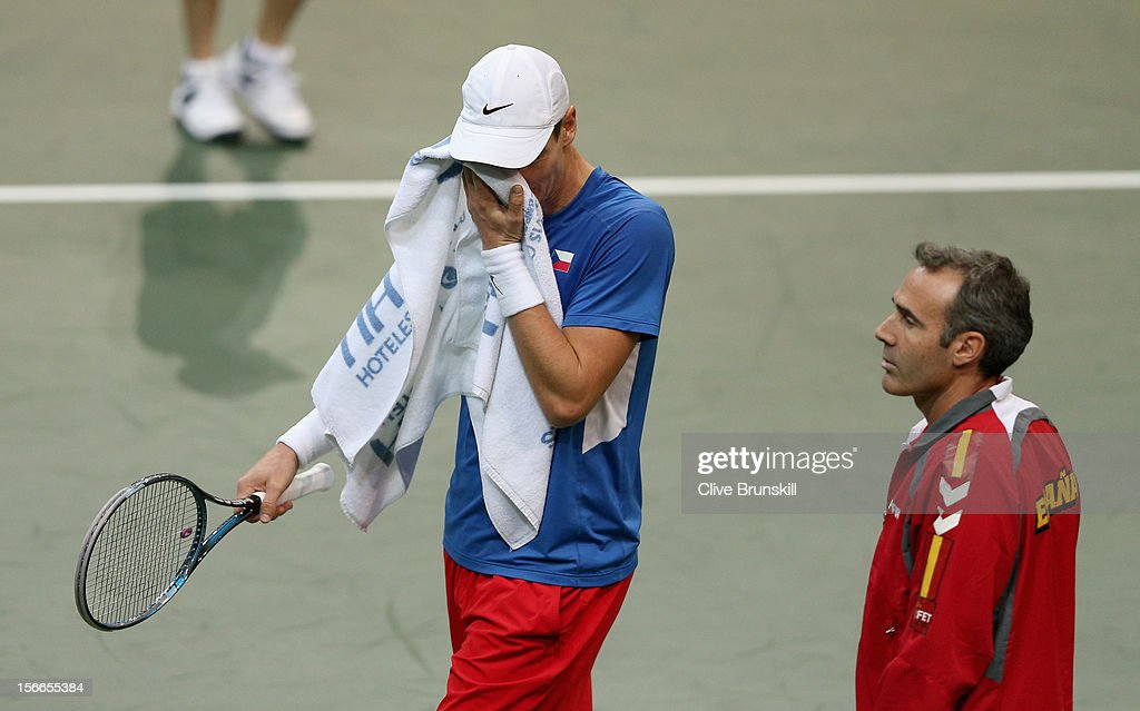 <a gi-track='captionPersonalityLinkClicked' href=/galleries/search?phrase=Tomas+Berdych&family=editorial&specificpeople=239147 ng-click='$event.stopPropagation()'>Tomas Berdych</a> of Czech Republic shows his dejection watched by Spain's team captain <a gi-track='captionPersonalityLinkClicked' href=/galleries/search?phrase=Alex+Corretja&family=editorial&specificpeople=211620 ng-click='$event.stopPropagation()'>Alex Corretja</a> during his straight sets defeat by David Ferrer of Spain during day three of the final Davis Cup match between Czech Republic and Spain at the 02 Arena on November 18, 2012 in Prague, Czech Republic.