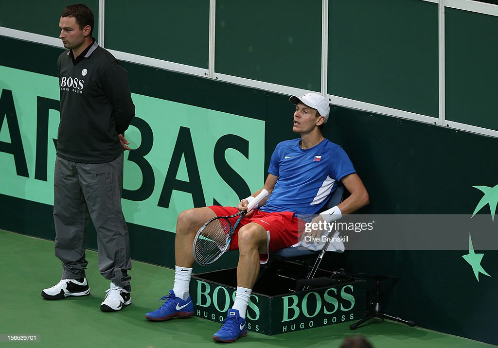 Tomas Berdych of Czech Republic sits exhausted in a linesmans chair during his five set win against Nicolas Almagro of Spain during day one of the final Davis Cup match between Czech Republic and Spain at the 02 Arena on November 16, 2012 in Prague, Czech Republic.