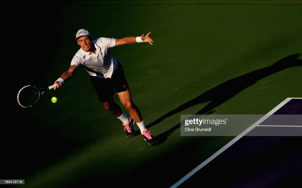 Tomas Berdych of Czech Republic stretches to play a forehand against Daniel Gimeno-Traver of Spain during their second round match at the Sony Open at Crandon Park Tennis Center on March 23, 2013 in Key Biscayne, Florida.