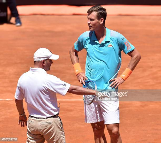 Tomas Berdych of Czech Republic talks with the judge referee during the match between Tomas Berdych of Czech Republic and Mischa Zverev of Germany...