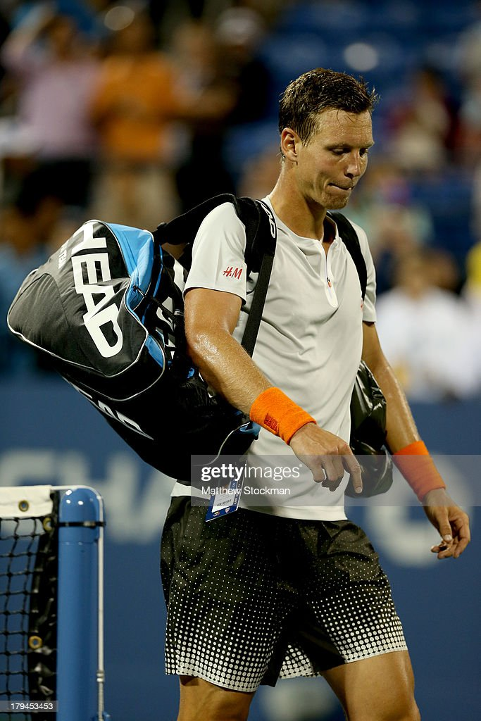 Tomas Berdych of Czech Republic walks off court after losing his men's singles fourth round match against Stanislas Wawrinka of Switzerland on Day Nine of the 2013 US Open at USTA Billie Jean King National Tennis Center on September 3, 2013 in the Flushing neighborhood of the Queens borough of New York City.