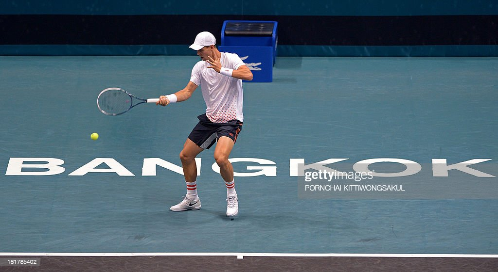 Tomas Berdych of Czechoslovakia returns to Roberto Bautista Agut of Spain during the second round of the Tennis ATP Thailand Open 2013 tournament in Bangkok on September 25, 2013.