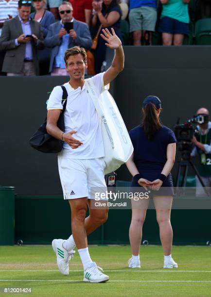 Tomas Berdych of The Czech Republic acknowledges the crowd as he celebrates after the Gentlemen's Singles fourth round match against Dominic Thiem of...