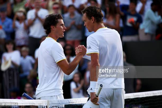 Tomas Berdych of The Czech Republic and Dominic Thiem of Austria shake hands after the Gentlemen's Singles fourth round match on day seven of the...