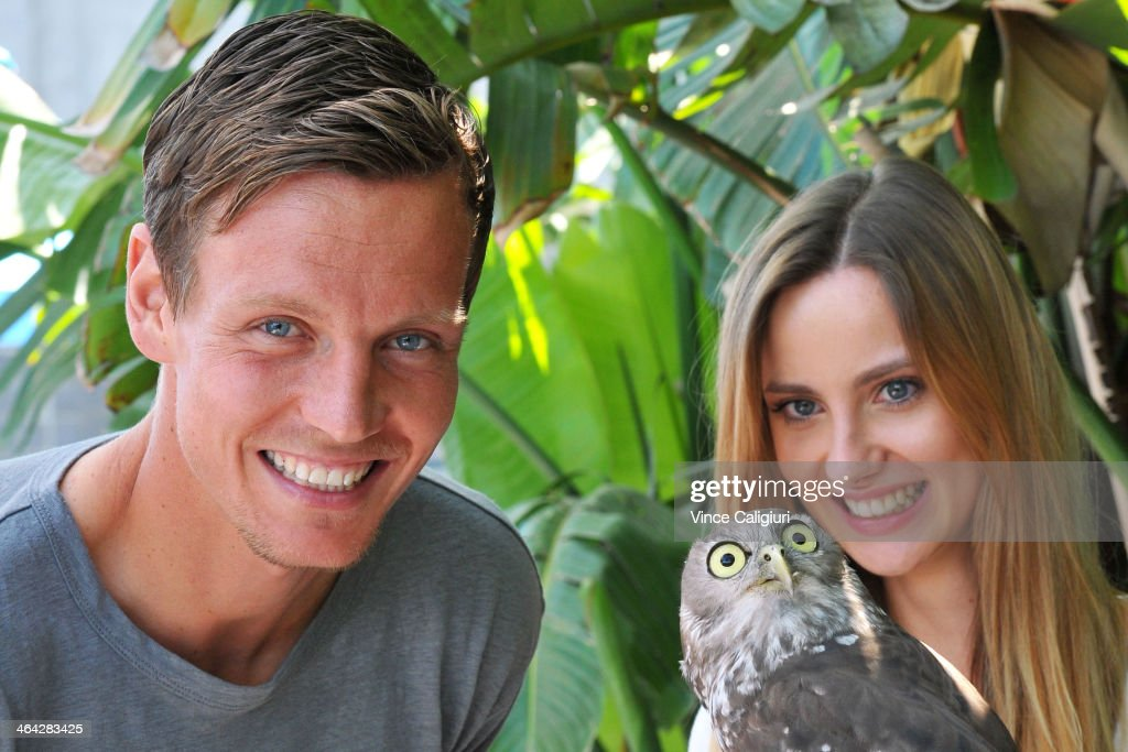 Tomas Berdych of the Czech Republic and girlfriend Ester Satorova pose with a barking Owl at the player cafe during day 10 of the 2014 Australian...