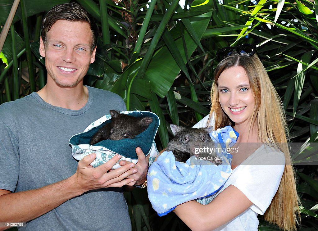 Tomas Berdych of the Czech Republic and girlfriend Ester Satorova pose with Wombats at the player cafe during day 10 of the 2014 Australian Open at Melbourne Park on January 22, 2014 in Melbourne, Australia.
