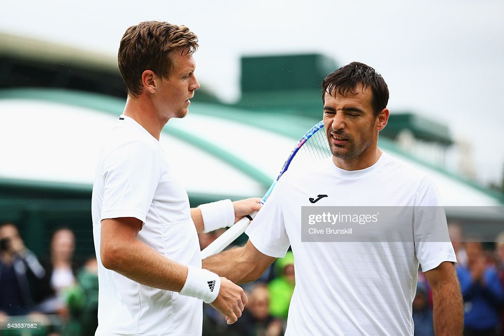 <a gi-track='captionPersonalityLinkClicked' href=/galleries/search?phrase=Tomas+Berdych&family=editorial&specificpeople=239147 ng-click='$event.stopPropagation()'>Tomas Berdych</a> of The Czech republic and <a gi-track='captionPersonalityLinkClicked' href=/galleries/search?phrase=Ivan+Dodig&family=editorial&specificpeople=4888715 ng-click='$event.stopPropagation()'>Ivan Dodig</a> of Croatia shake hands following the Men's Singles first round match on day three of the Wimbledon Lawn Tennis Championships at the All England Lawn Tennis and Croquet Club on June 29, 2016 in London, England.