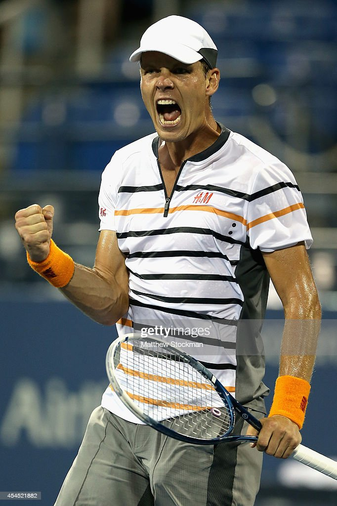 Tomas Berdych of the Czech Republic celebrates after defeating Dominic Thiem of Austria during their men's singles fourth round match on Day Nine of...