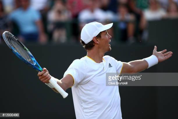 Tomas Berdych of The Czech Republic celebrates match point and victory after the Gentlemen's Singles fourth round match against Dominic Thiem of...