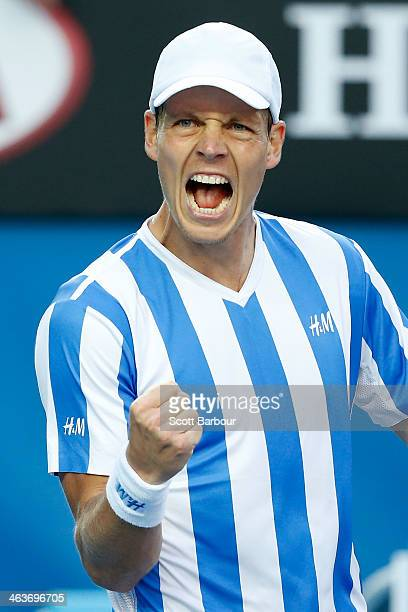 Tomas Berdych of the Czech Republic celebrates winning his fourth round match against Kevin Anderson of South Africa during day seven of the 2014...