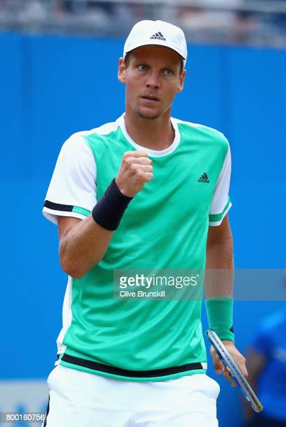 Thomas Berdych of The Czech Republic celebrates winning the second set during the mens singles quarter final match against Feliciano Lopez of Spain...