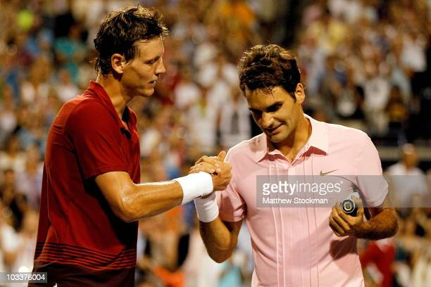 Tomas Berdych of the Czech Republic congratulates Roger Federer of Switzerland after their match during the quarterfinals of the Rogers Cup at the...