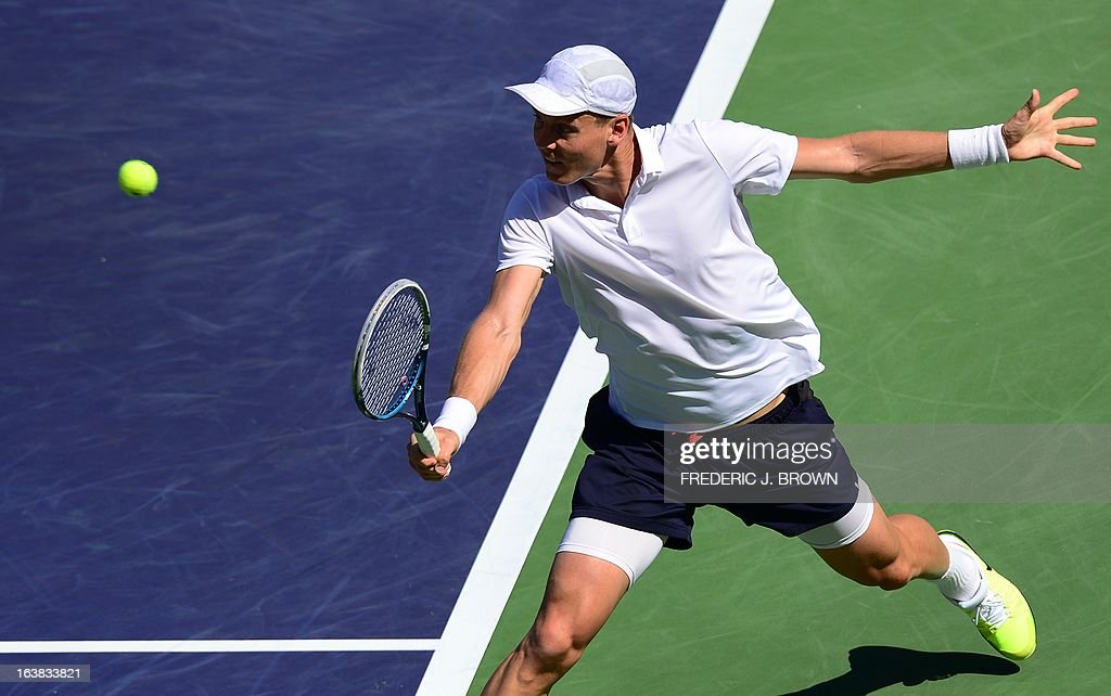 Tomas Berdych of the Czech Republic hits a backhand return against Rafael Nadal of Spain on March 16, 2013 in Indian Wells, California, during their semifinal match at the BNP Paribas Open. AFP PHOTO/Frederic J. BROWN