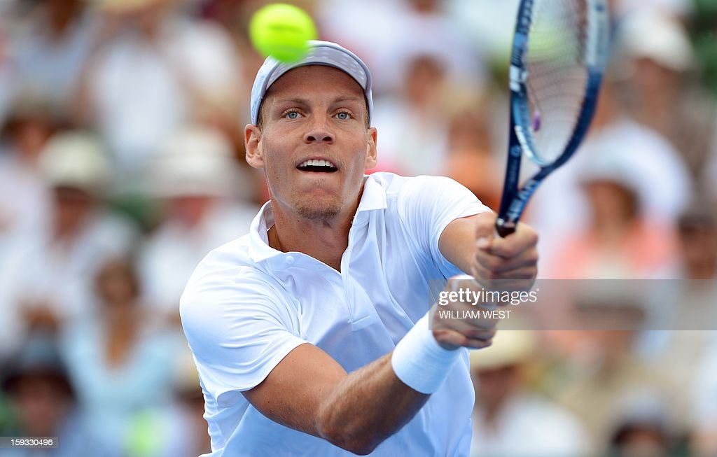 Tomas Berdych of the Czech Republic hits a backhand return during his victory over Marcos Baghdatis of Cyprus in the 3rd and 4th play-off match at the Kooyong Classic in Melbourne on January 12, 2013. AFP PHOTO/William WEST USE