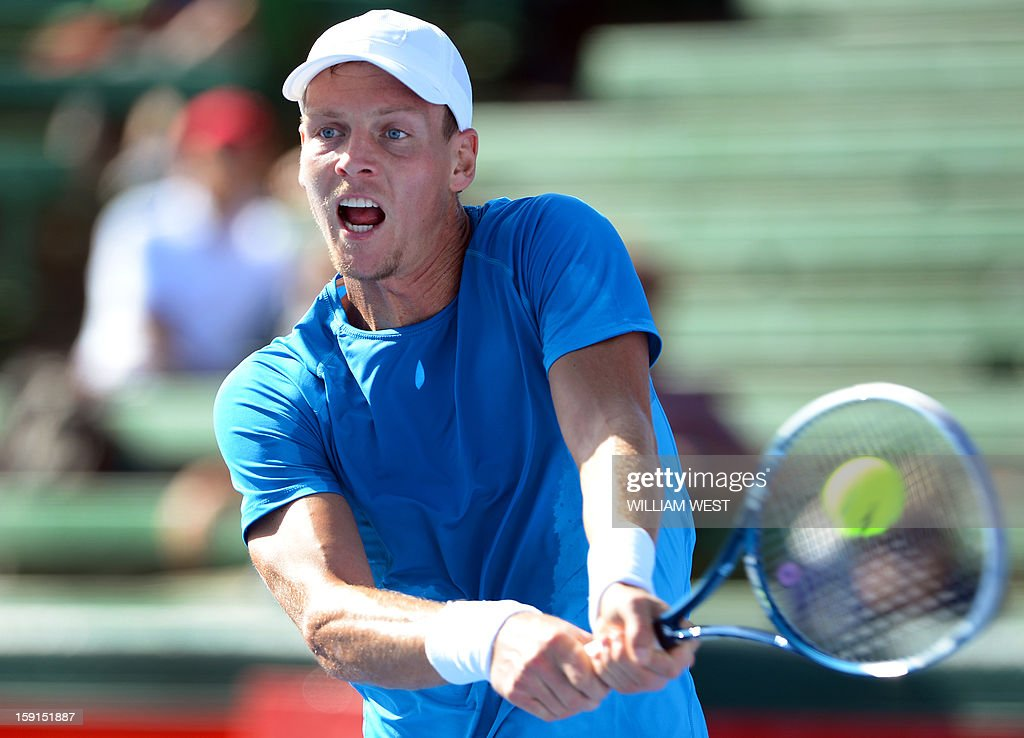 Tomas Berdych of the Czech Republic hits a backhand return to Ivan Dodig of Croatia at the Kooyong Classic tennis tournament in Melbourne on January 9, 2013. Top male players are using the round-round invitational tournament as a warm up to the Australian Open tennis tournament which runs from January 14 to 27. AFP PHOTO/William WEST USE