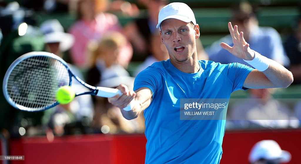Tomas Berdych of the Czech Republic hits a forehand return to Ivan Dodig of Croatia at the Kooyong Classic tennis tournament in Melbourne on January 9, 2013. Top male players are using the round-round invitational tournament as a warm up to the Australian Open which runs January 14-27. AFP PHOTO/William WEST IMAGE