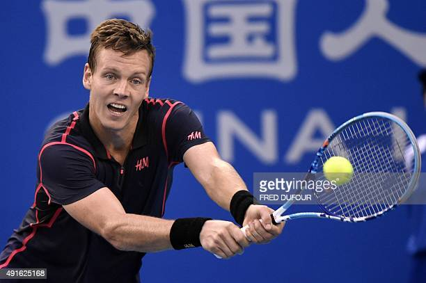 Tomas Berdych of the Czech Republic hits a return against Pablo Cuevas of Uruguay during their first round men's singles match at the China Open...