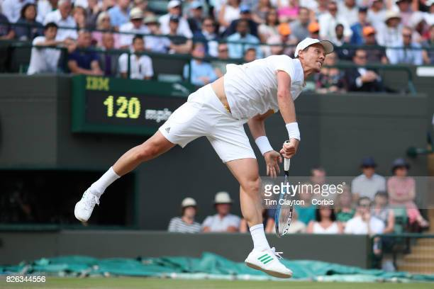 Tomas Berdych of the Czech Republic in action against Novak Djokovic of Serbia in the Mens' Singles Quarter Final match on Court One during the...