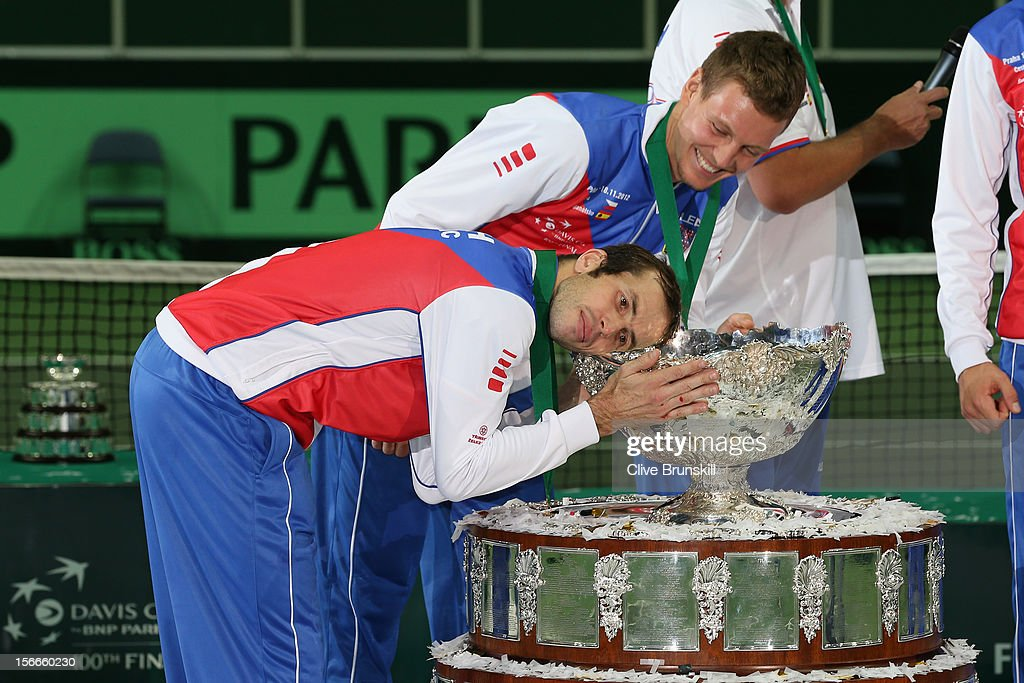 Tomas Berdych of the Czech Republic laughs at his team mate Radek Stepanek as he hugs the trophy after a 3-2 victory against Spain during day three of the final Davis Cup match between Czech Republic and Spain at the 02 Arena on November 18, 2012 in Prague, Czech Republic.
